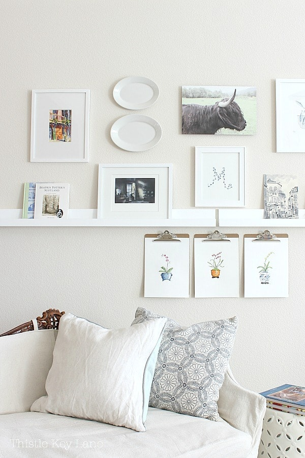 Decorating with plate on a gallery wall.