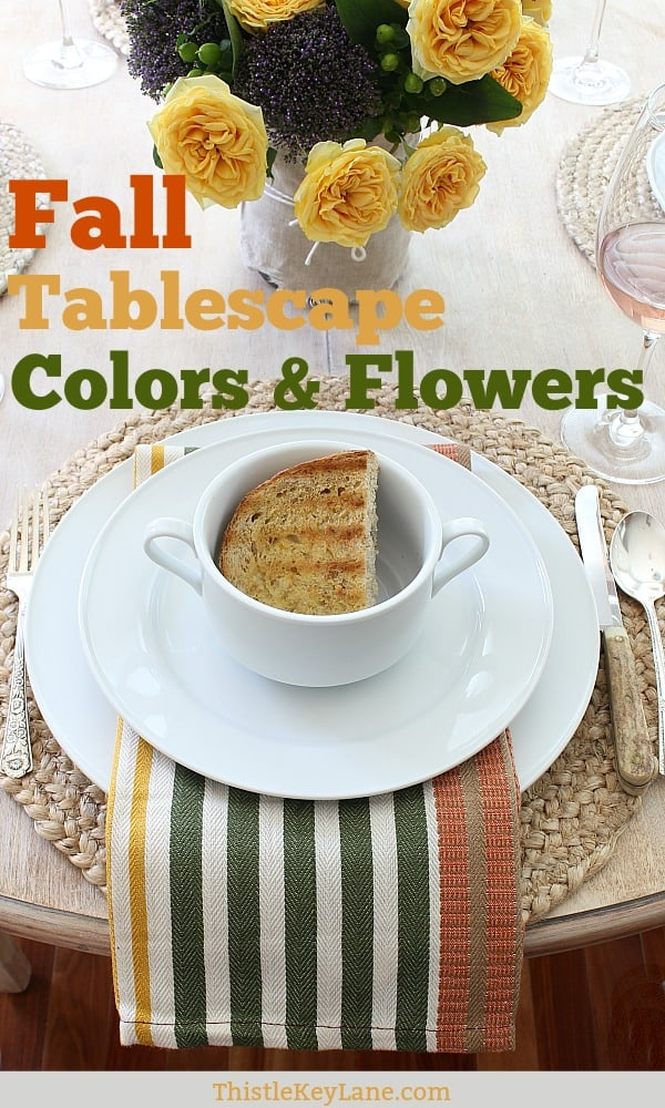 Easy fall tablescape with autumn colors and flowers.
