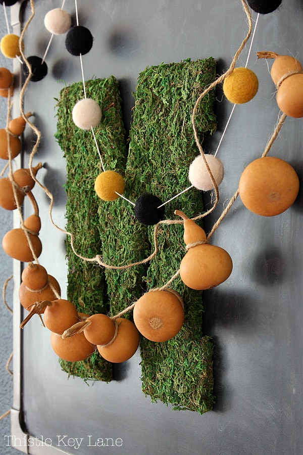Transitioning Summer To Fall Kitchen Ideas with a gourd garland..