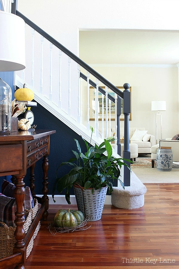 Fall entryway with view of stairs and living room.
