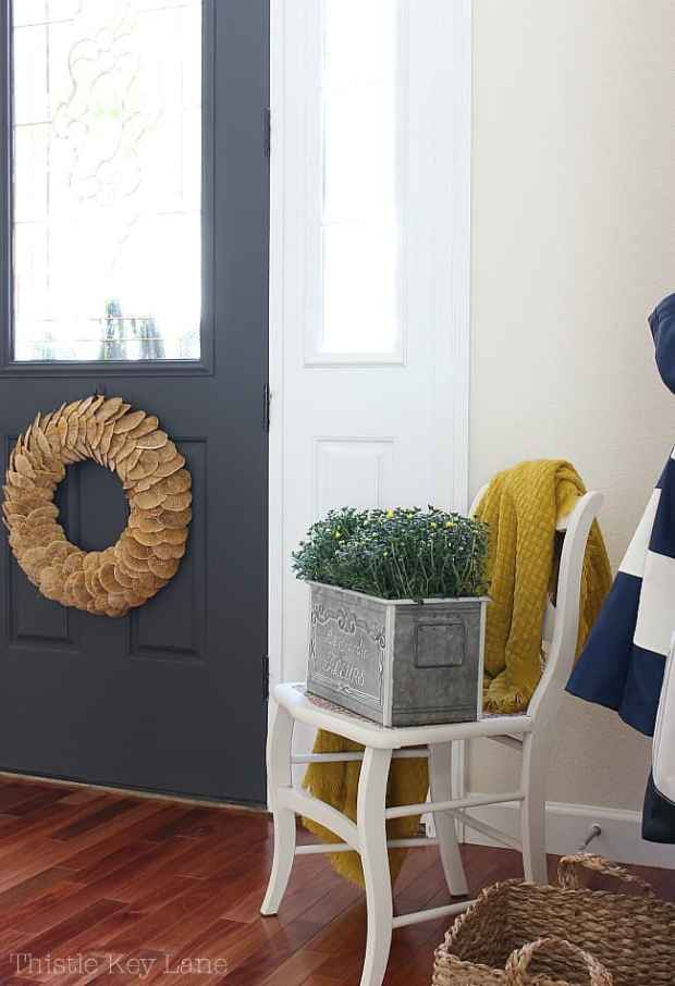 Fall Entryway With Navy And Yellow - large wreath on the inside of the door.