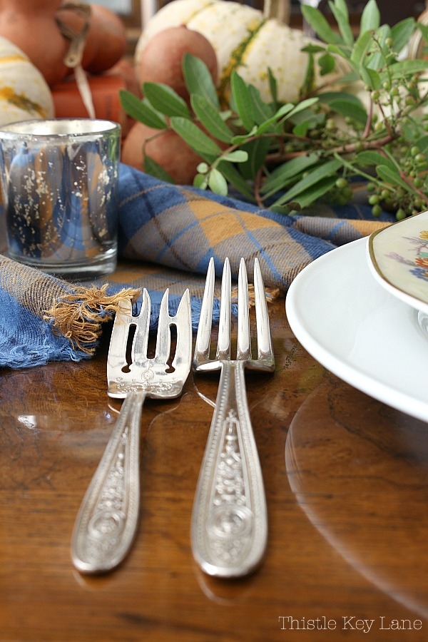 Easy Thanksgiving Tablescape Using Gourds And Plaid with vintage pieces.