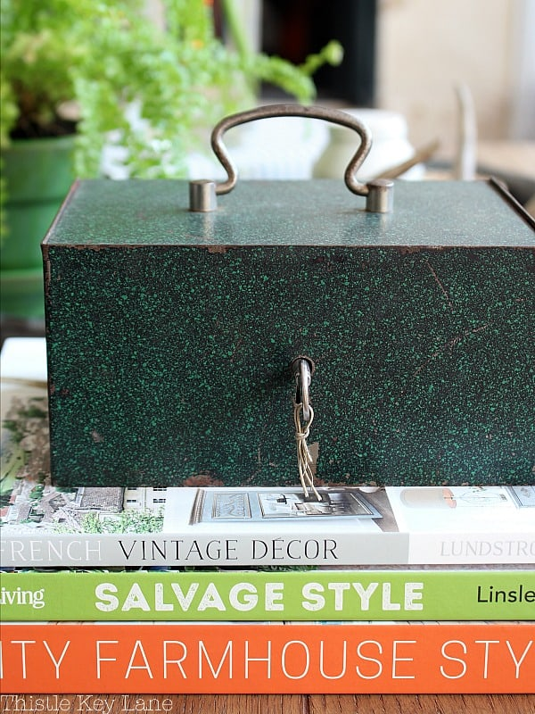 Decorating with a green lock box and green books.