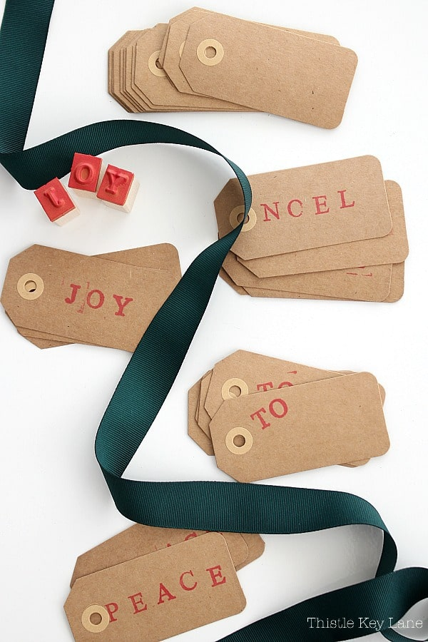 Gift tags stamped with Noel, Joy and Peace.