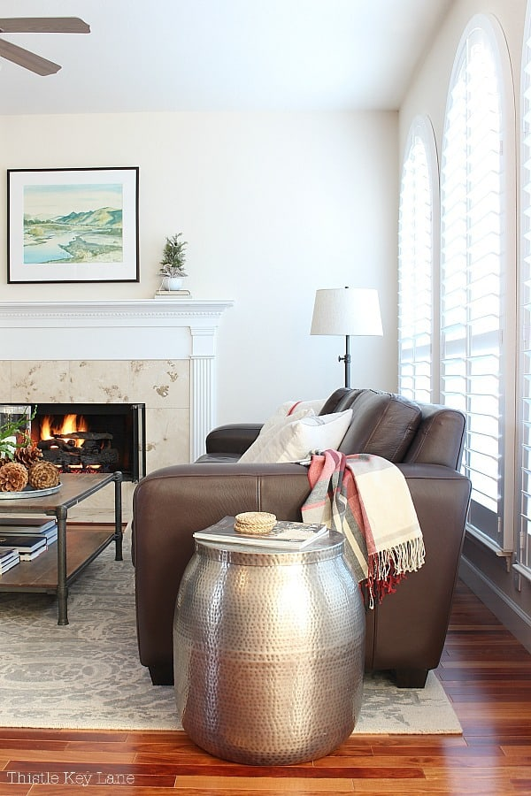Winter Decorating Family Room Tour - view of brown leather sofa, coffee table and fireplace.