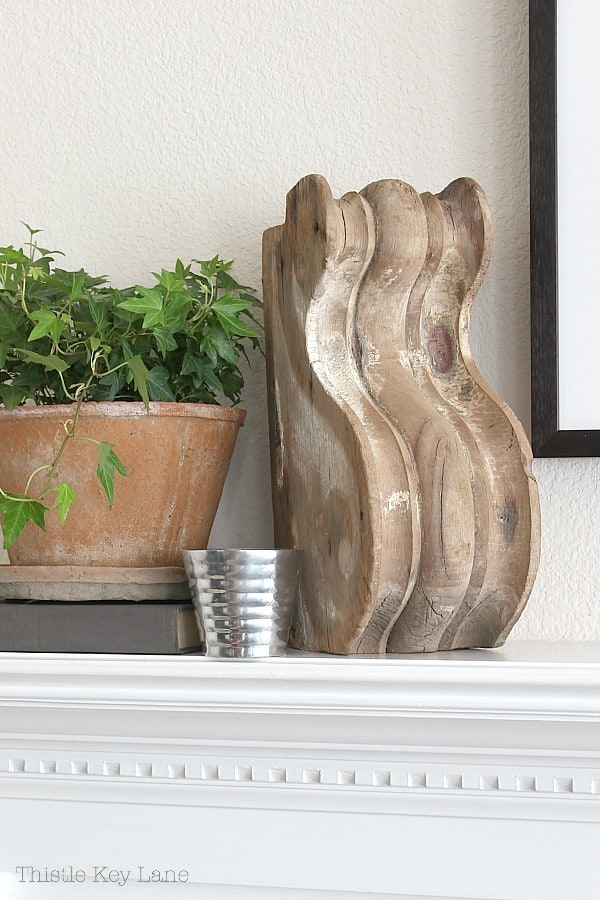 Vintage corbel, green ivy and a pewter candle holder.