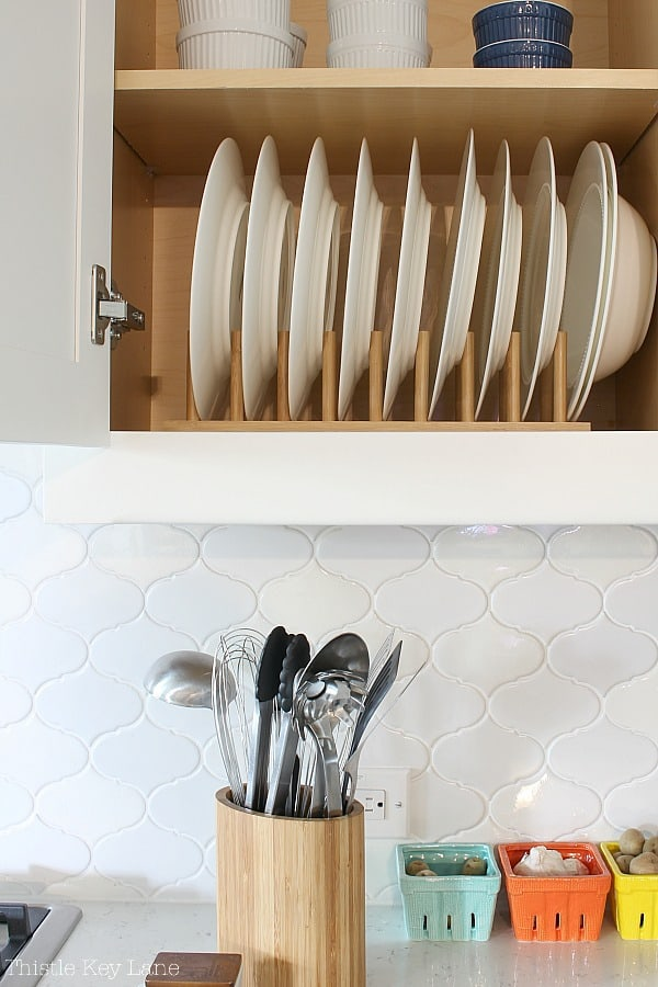 Easy Kitchen Organizing Tips - with cabinet plate racks