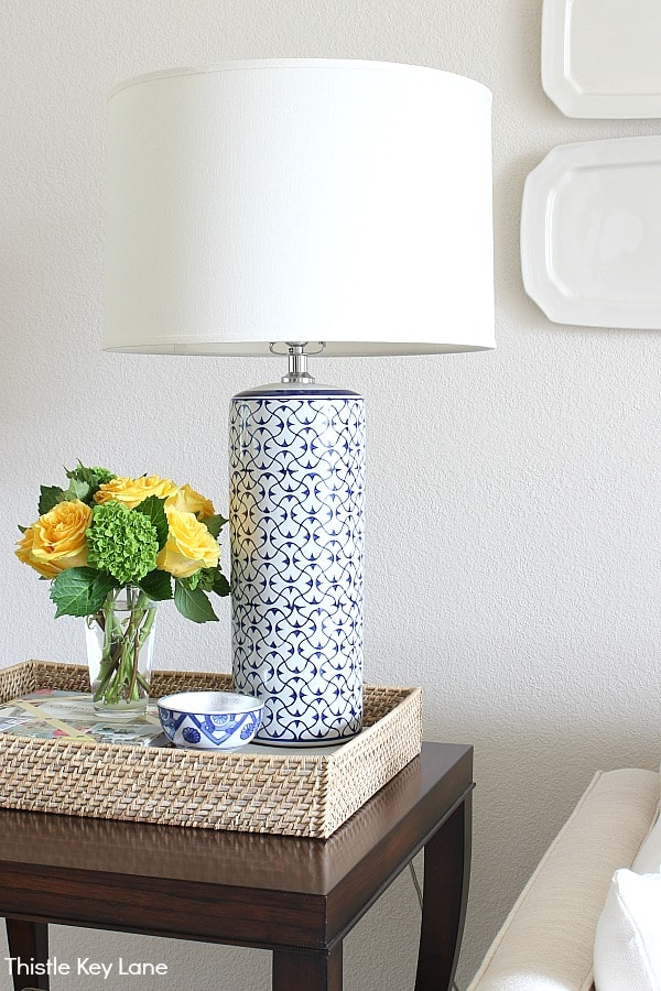 How To Style An End Table - blue and white ceramic lamp.
