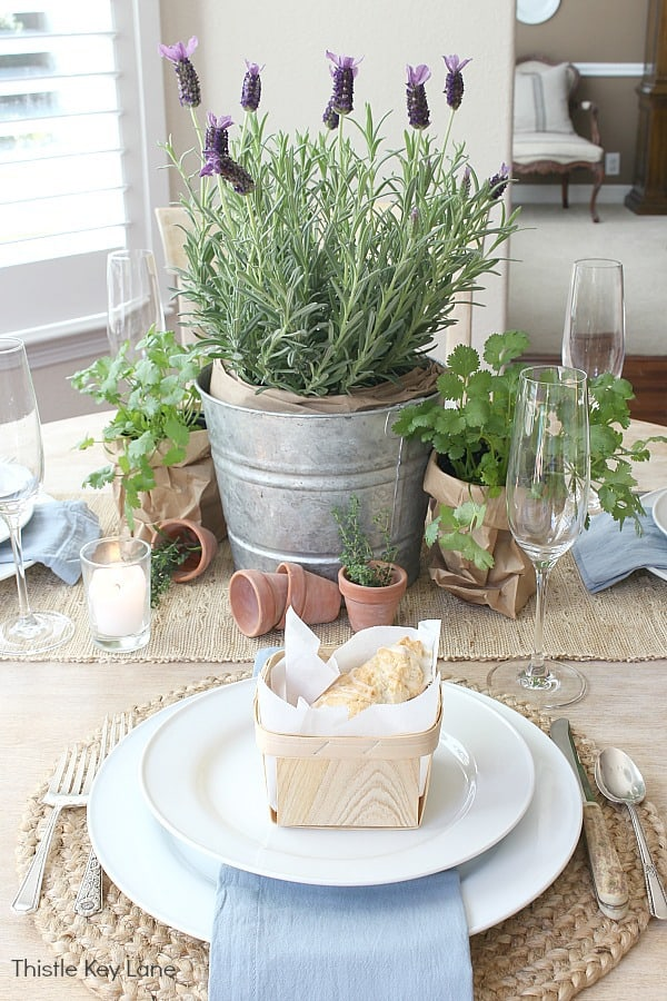 Garden Tablescape With Herbs - candles and neutral texture.