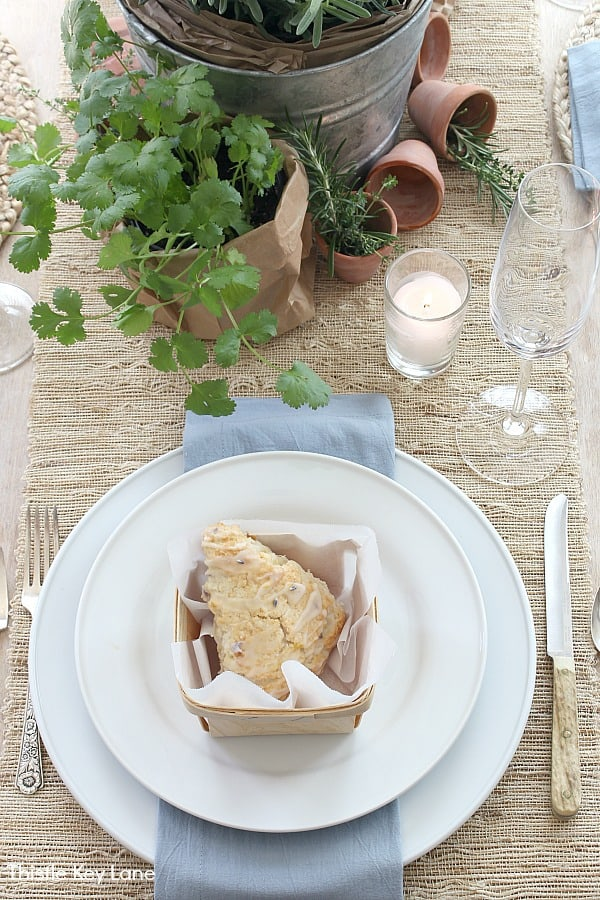 Garden Tablescape With Herbs and White Dinnerware.