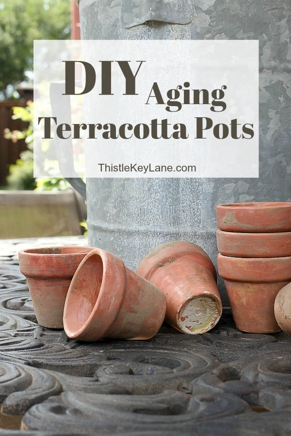 DIY Aging Terracotta Pots - on outside table.