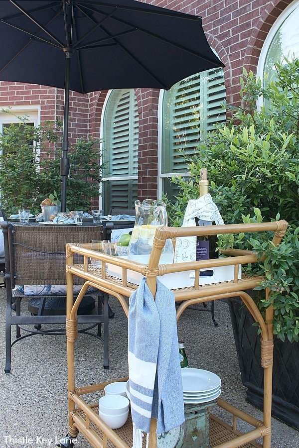 Relaxing Patio Style With Blue And White Accents - outdoor rattan bar cart.