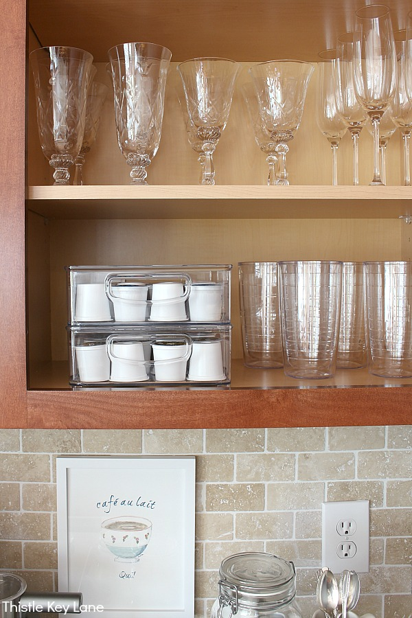 Cabinet organization over coffee station.