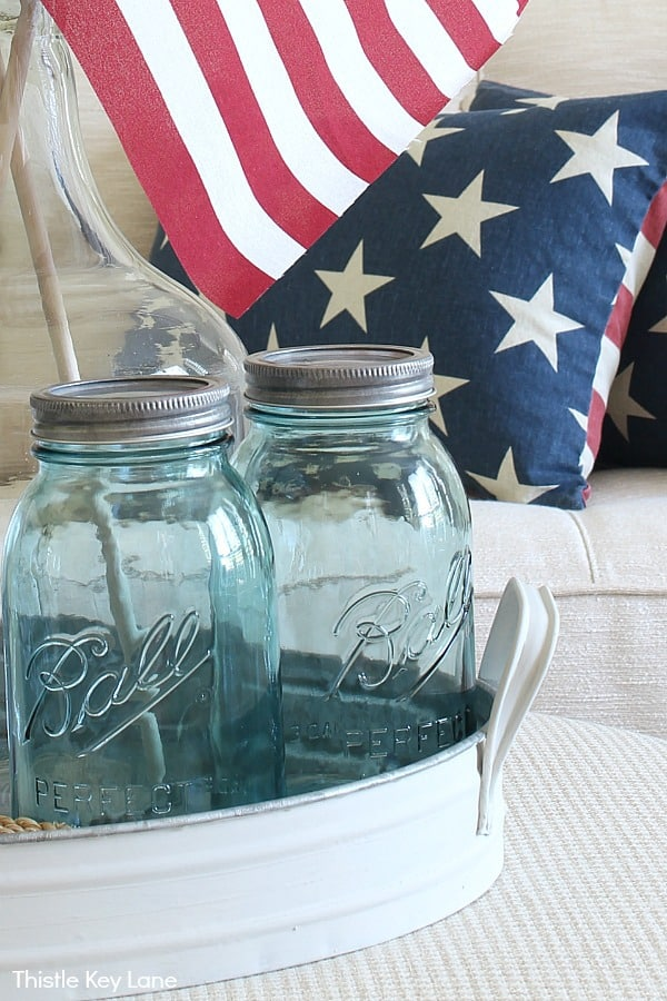 Blue jars and pillows with starts and stripes.