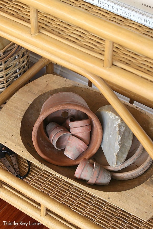 Terra cotta pots sitting inside a dough bowl.