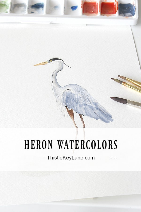 Introducing heron watercolors - Left facing heron with paint pallet and brushes.