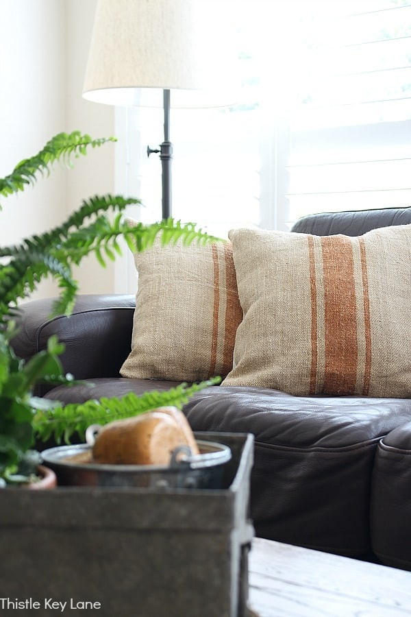 Grain sack pillow covers with a caramel stripes.