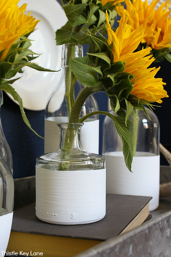 Sunflowers in individual vases.