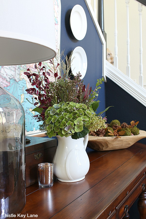 White ironstone pitcher with fall flowers on entry table. Styling A Simple Fall Entry Table .