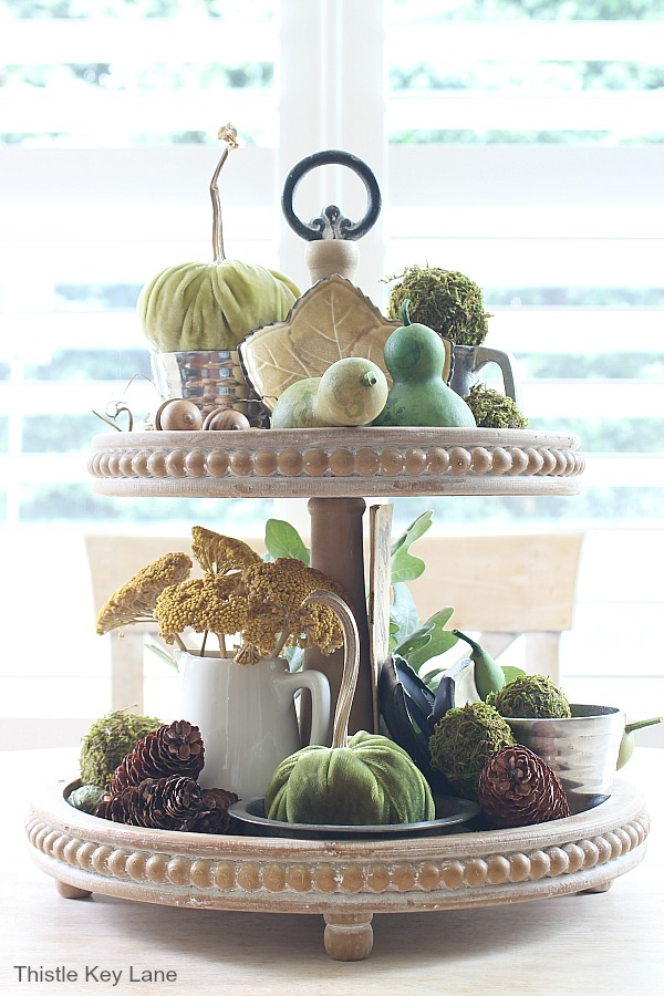 Full view of fall tiered tray with greens and browns.