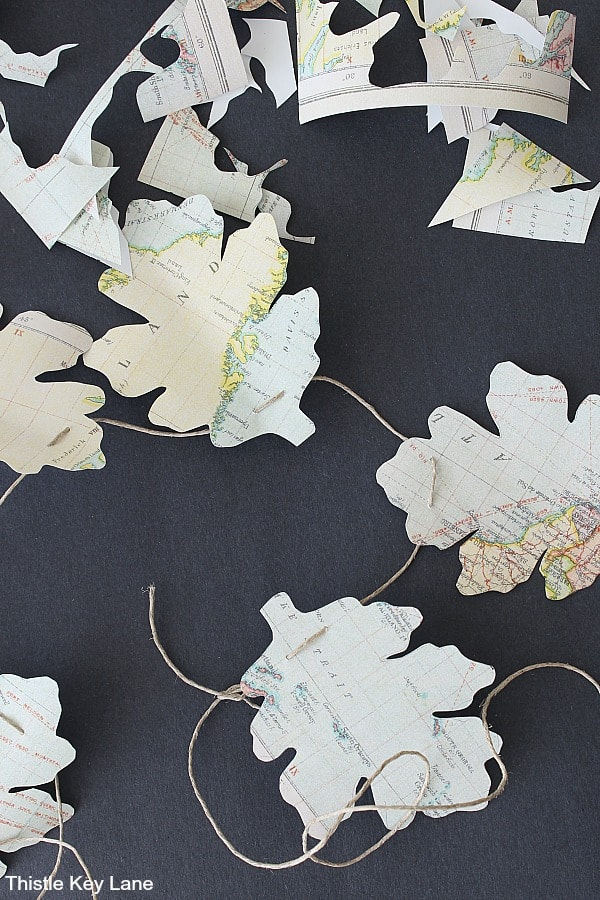 Close up of leaf shapes cut from a map.