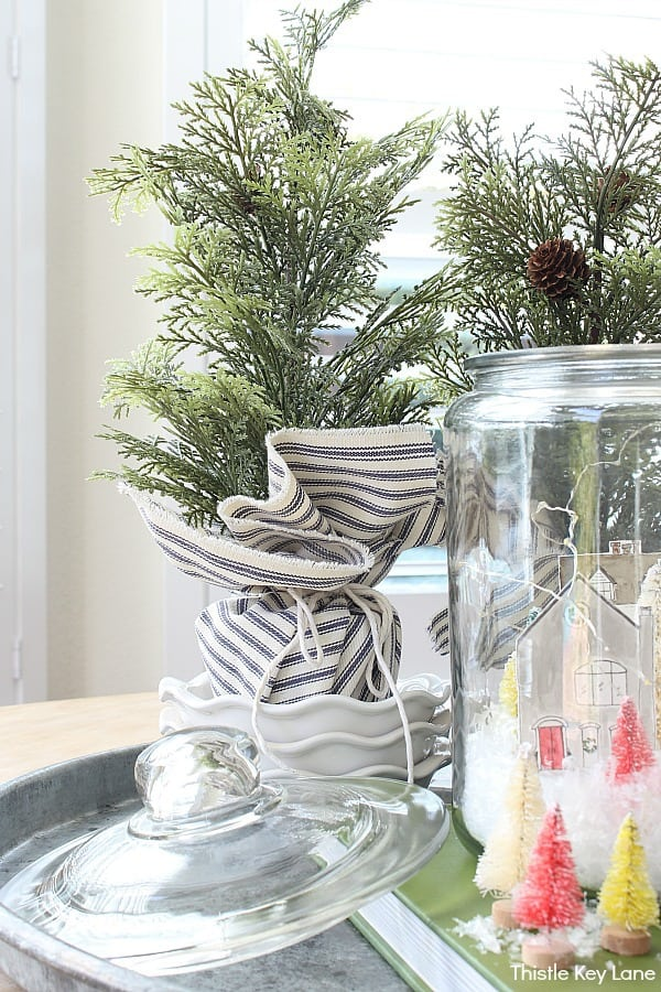 Holiday snow scene arranged on a tray. Snowy Village Houses In A Jar.