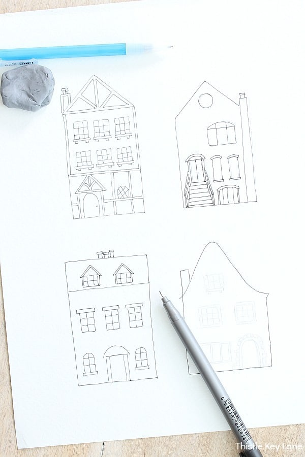 Drawing houses with pencil and ink.