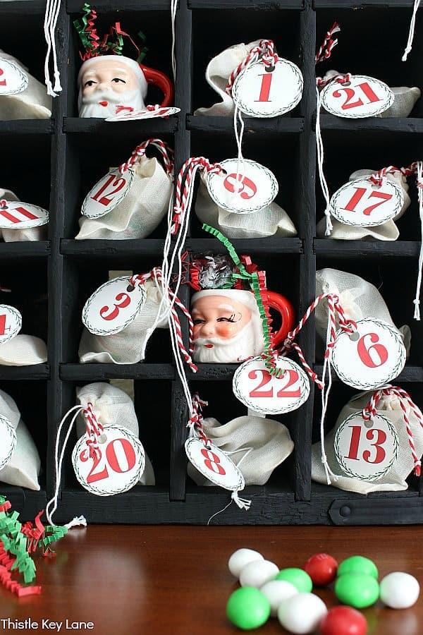 Muslin bags filled with treats. Advent Calendar Bags And Printable Numbers.
