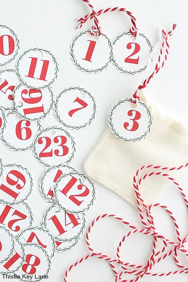 Round tags counting down 1 to 24. Advent Calendar Bags And Printable Numbers