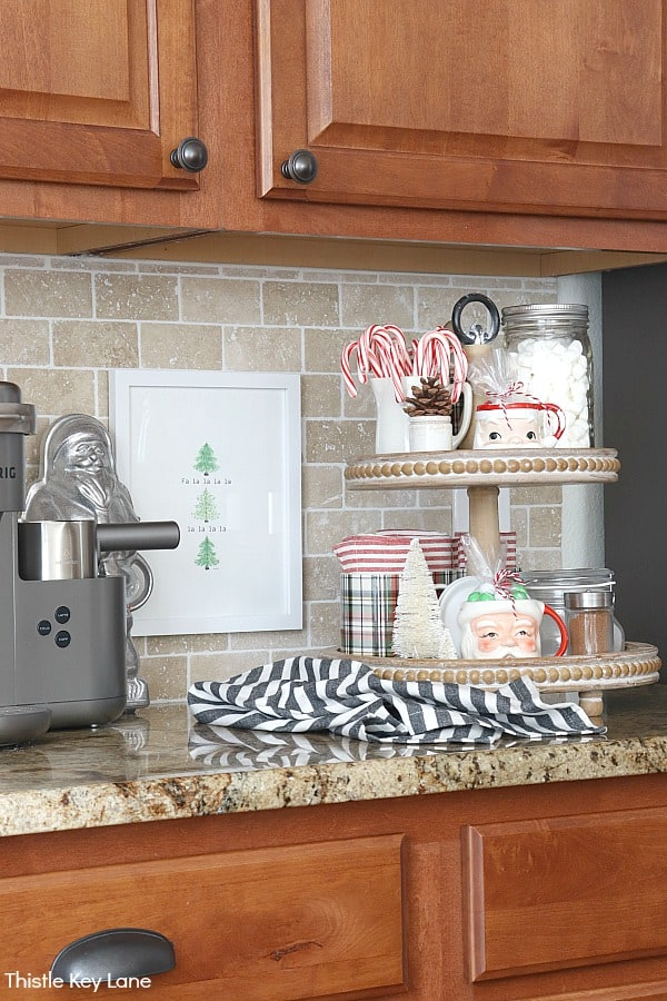 Coffee and hot chocolate bar with Christmas tiered tray. Christmas In The Kitchen And Family Room.
