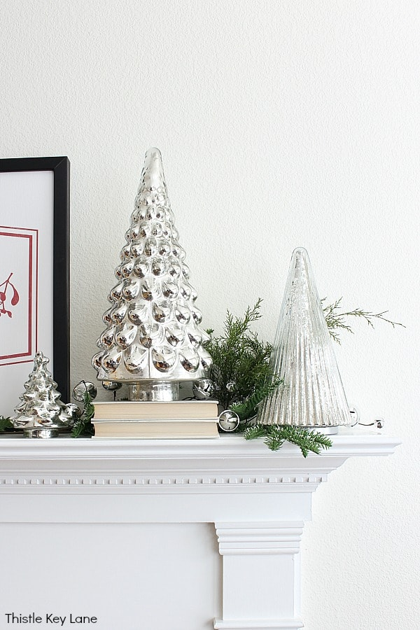 Mercury Glass Trees And Greenery. Cozy Christmas Mantel In Red And White.