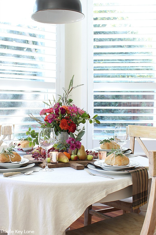 Cozy Thanksgiving Fruit And Flower Tablescape.