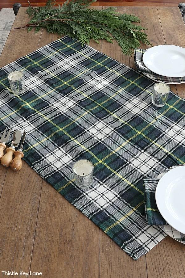 Plaid napkins create a tablecloth.