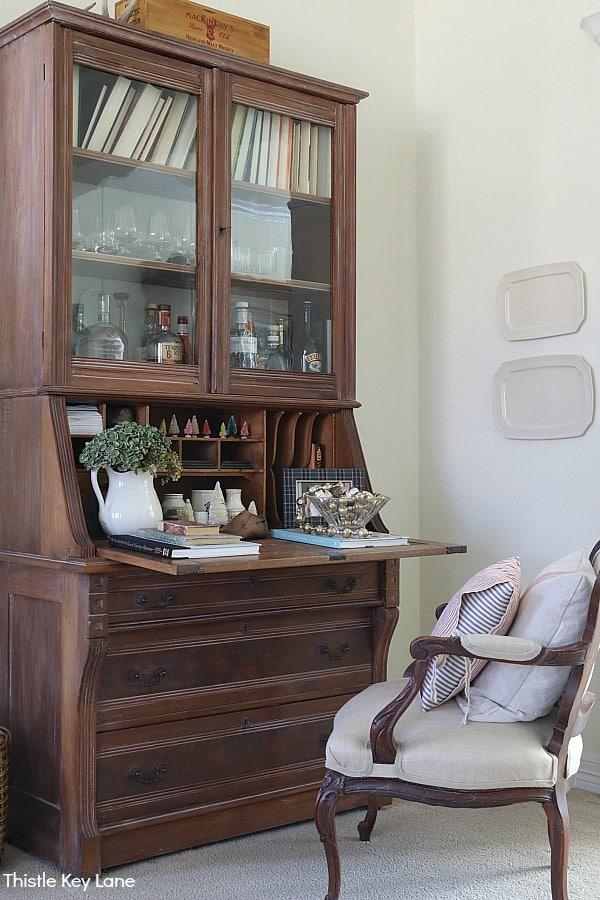 Tall secretary desk with French chair. White Bottle Brush Tree Vignette.