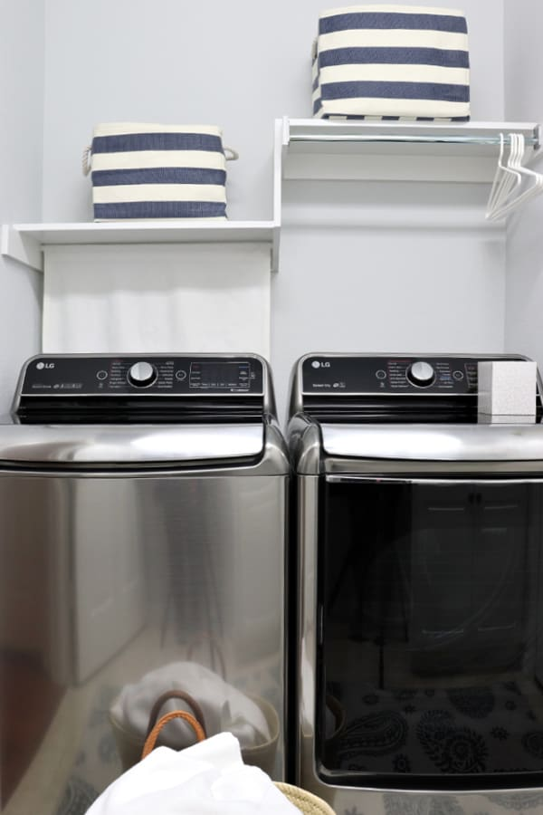 Top open washer and dryer with shelves and bins. Laundry Room Organizing Ideas.