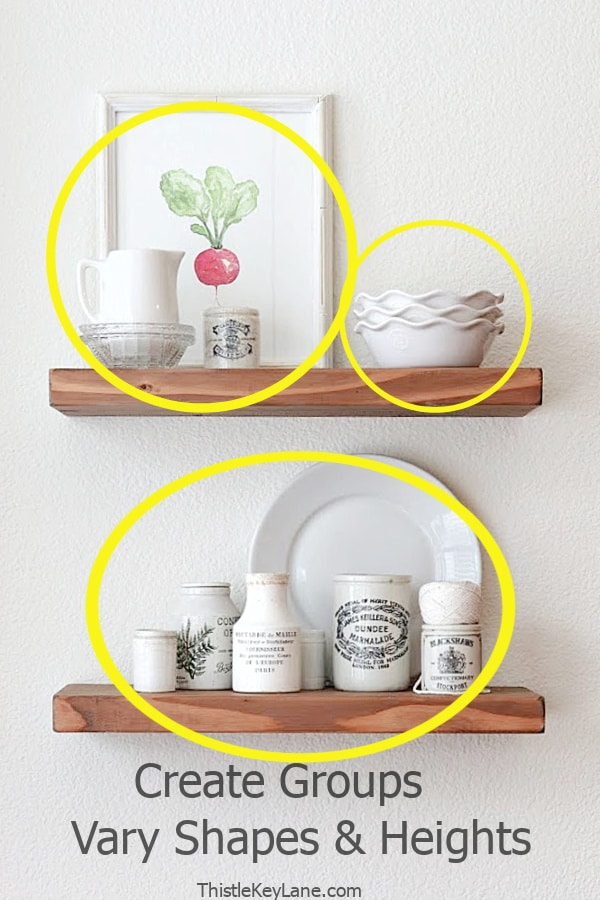 Decorating open shelves with odd numbered groups.