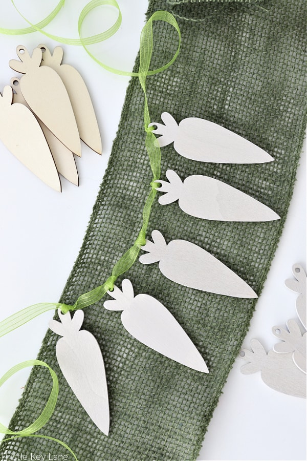 Carrot garland painted a neutral color on green ribbon.