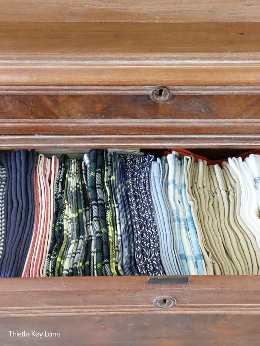 Organizing Napkins And Linens in a drawer.