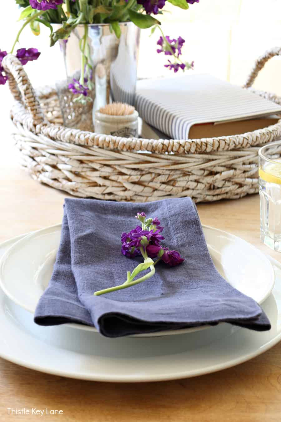 Indigo napkin with a flower on top. Organizing Napkins And Linens.
