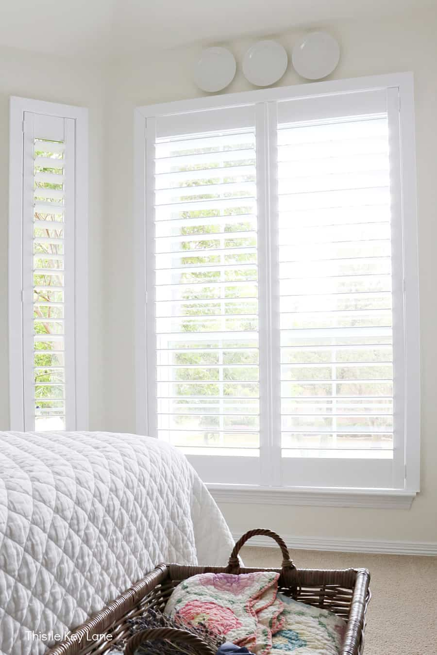 Large bedroom windows with shutters.