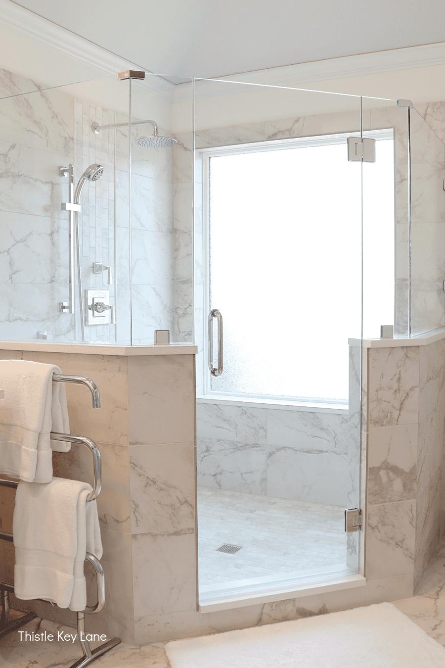Gray and white tile shower, frameless glass and door.