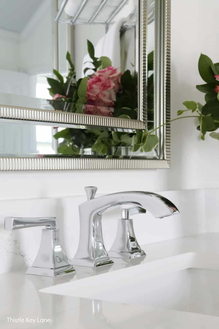 Chrome faucet and white quartz countertop. White And Gray Bathroom Makeover.