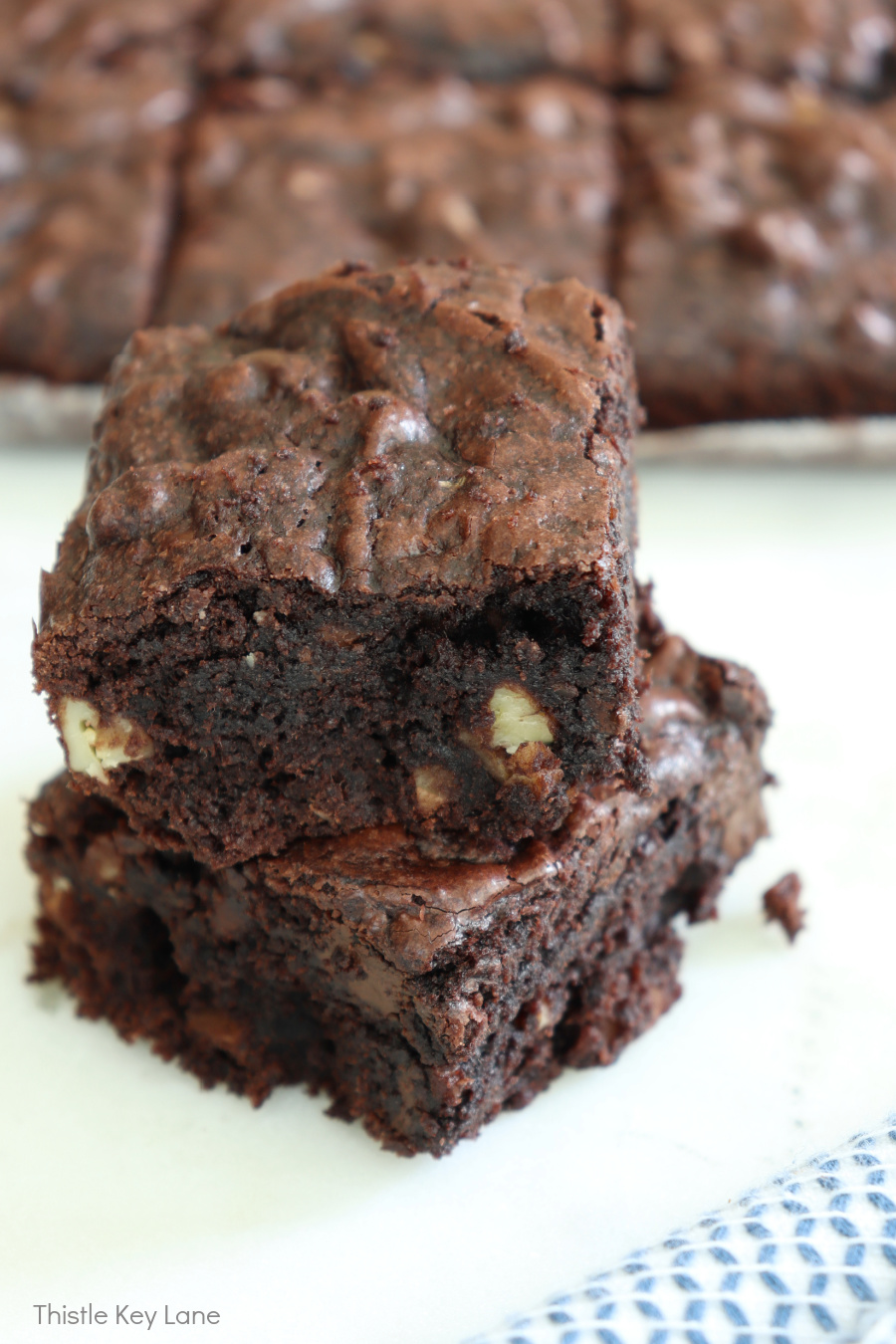 View of the flaky crust on a stack of brownies.