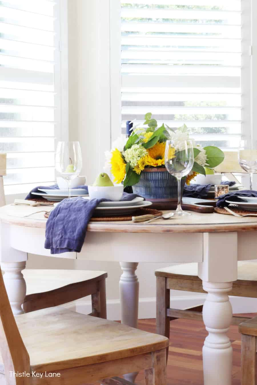 Table setting for an early fall with sunflowers.