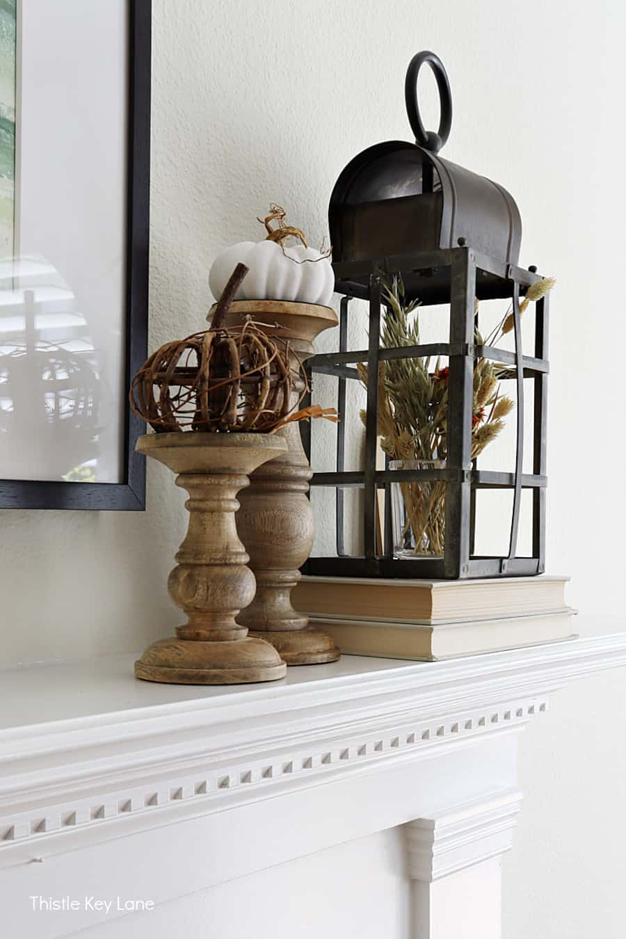 Wood candle holders for displaying pumpkins and a lantern.