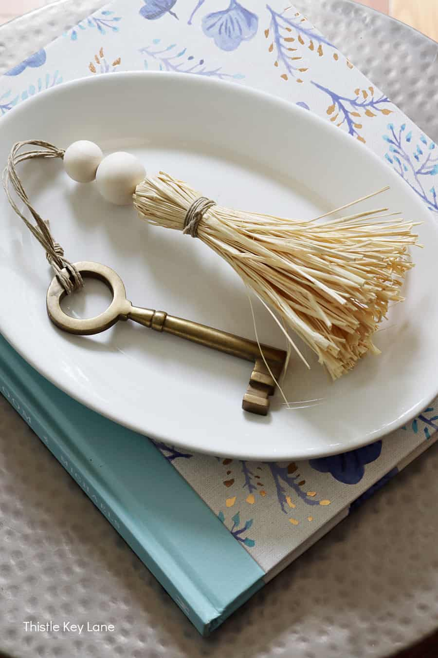 Key and tassel on an ironstone plate.