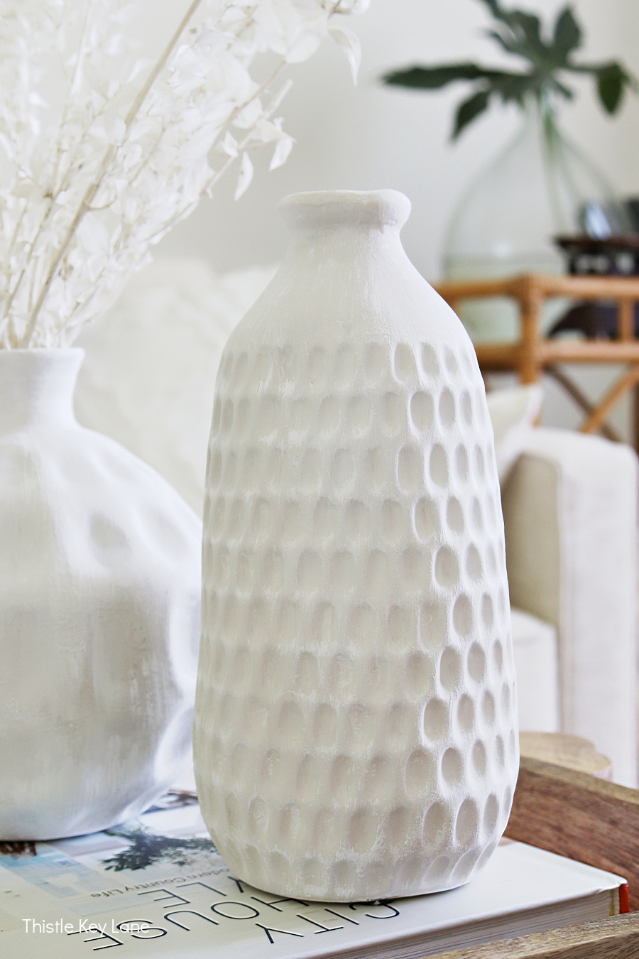 Tall ceramic vase with circle designs. Thrift Store Vase Makeover With Paint.