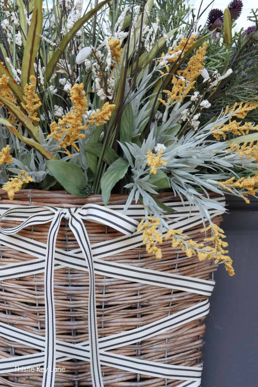Fall picks in a door basket. Simple Fall Porch And Entryway Ideas