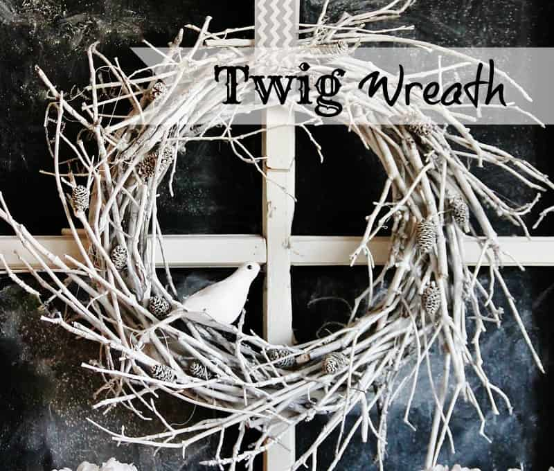 Assemble your supplies to make your twig wreath: twigs, hot glue, flat circle wreath form, tiny pine cones from craft store and ribbon.