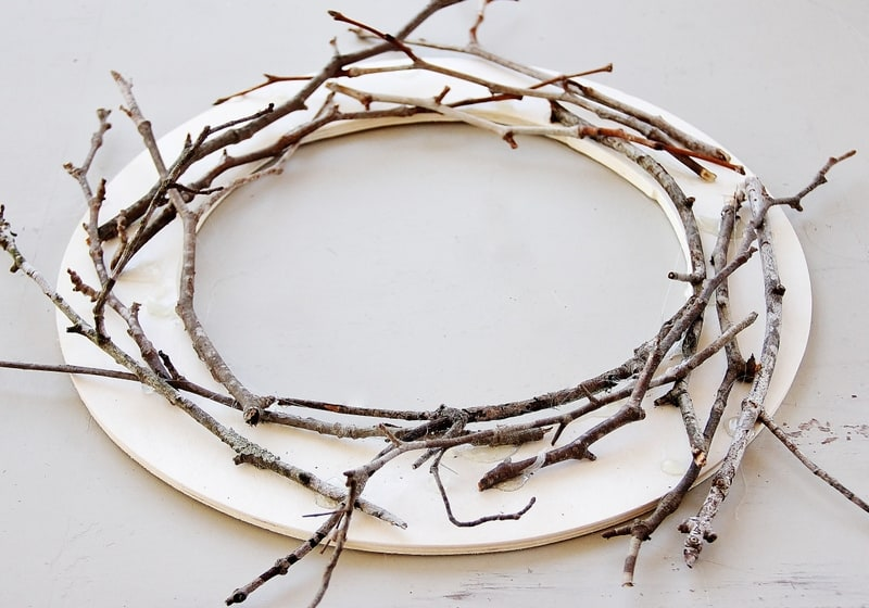 Continue to add branches to the circle to make a white twig wreath.